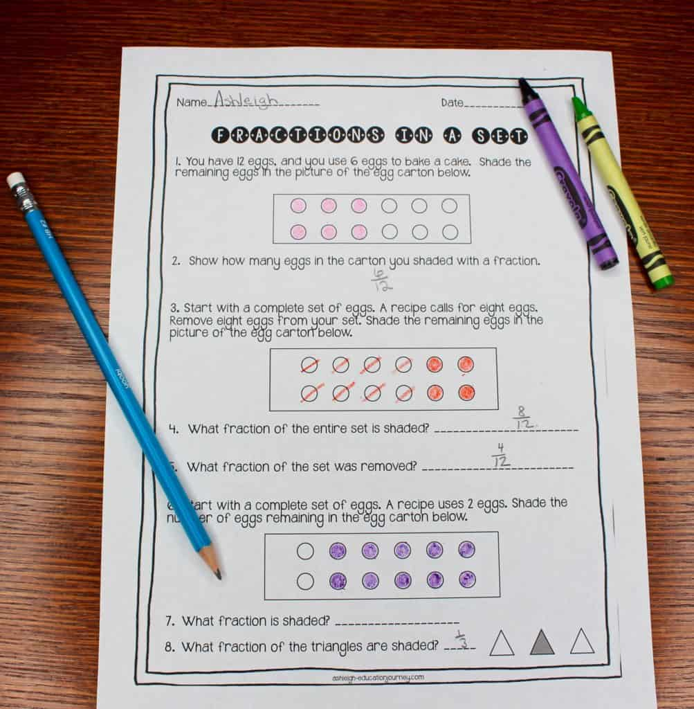 Fractions in a Set worksheet on wood table with pencil and crayons laying across the sheet