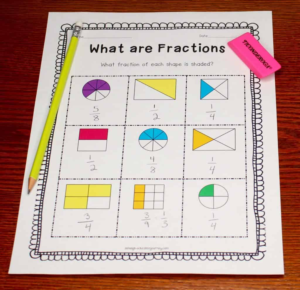 What are Fractions worksheet on wood table