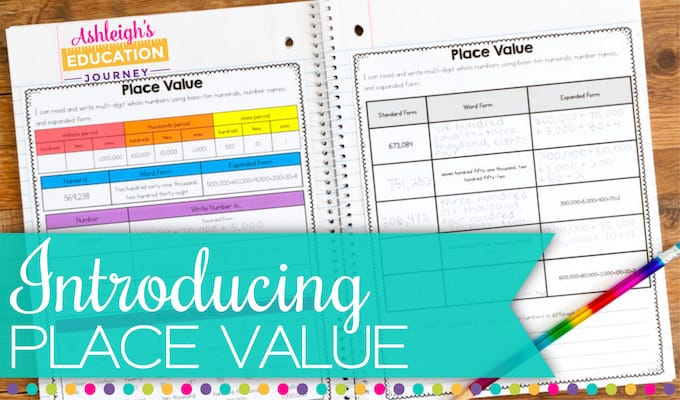 Introducing place value header with colorful worksheets on wood table