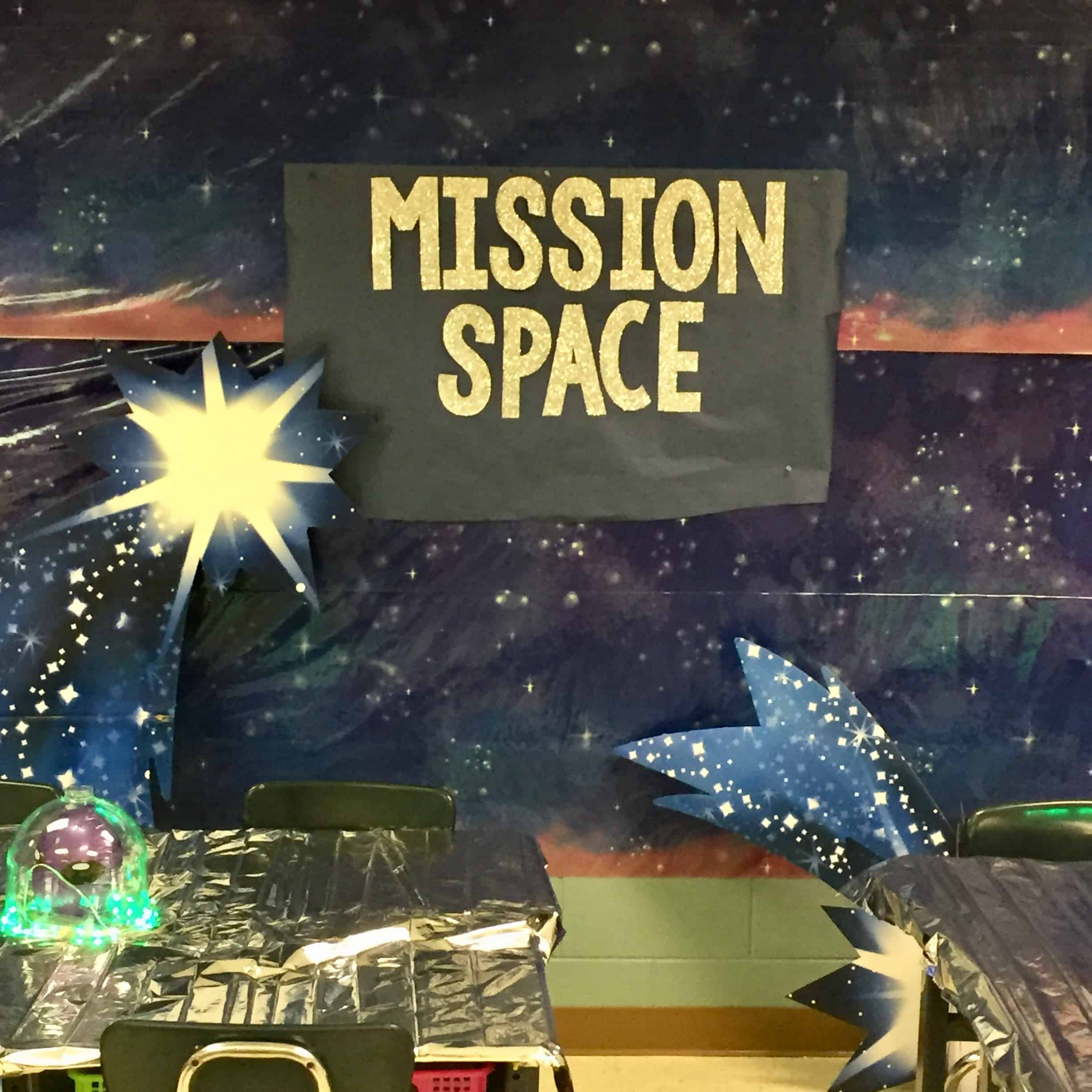 Teaching About Space: A starry backdrop with shooting stars, and Mission Space in glittering text on black paper.