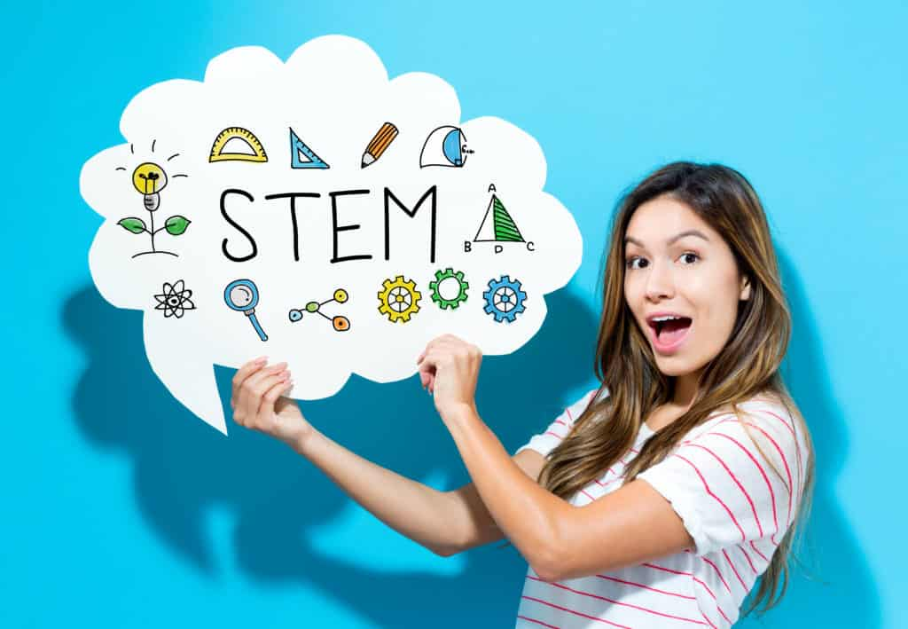 Woman holding an illustrated cloud with science-based icons and STEM inside, to illustrate STEM Lessons.