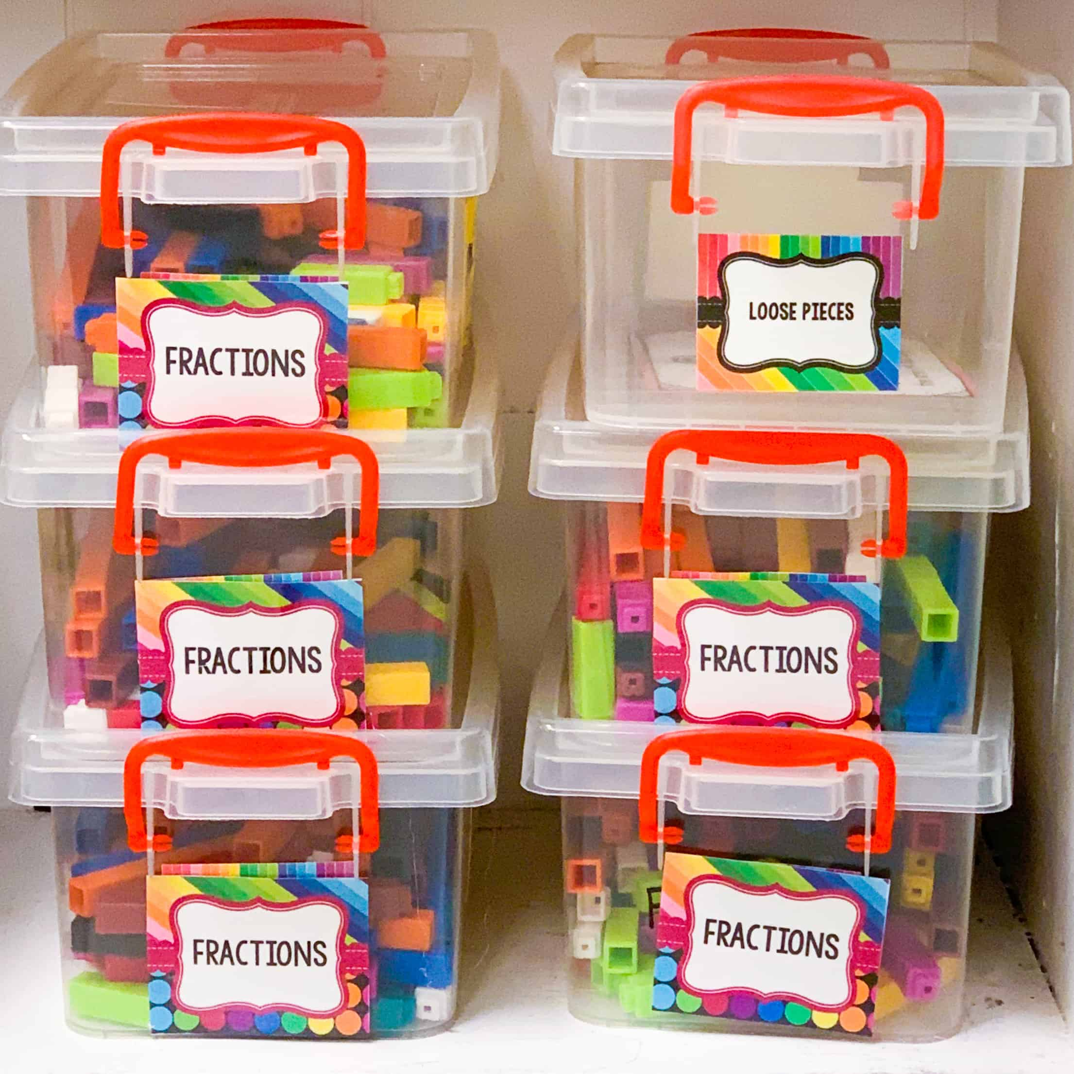 Six clear plastic containers, each containing different colorful math manipulative tools
