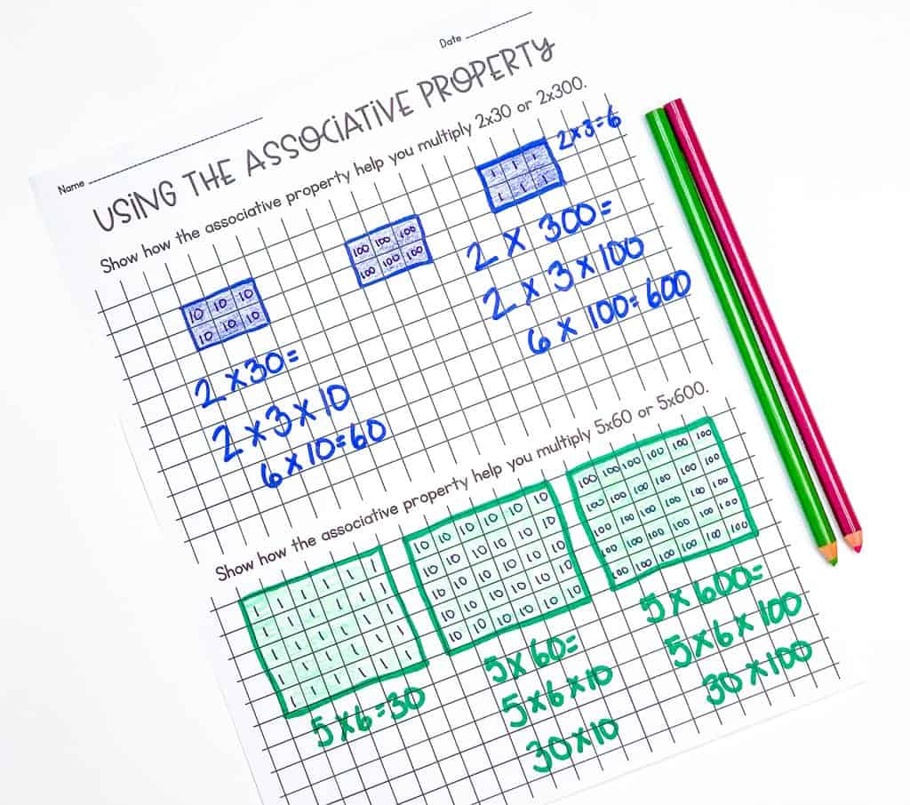 Multi-digit multiplication worksheet titled Using the Associative Property with groups of numbers highlighted